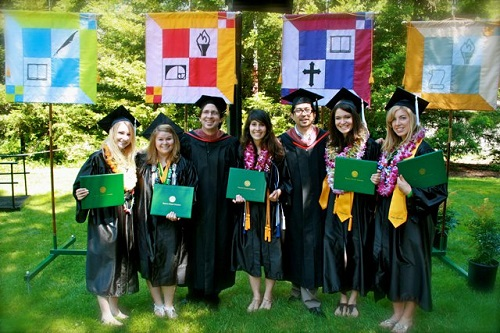 Visual Arts professors Cliff Rusch and Milbert Mariano with new PUC alumni.